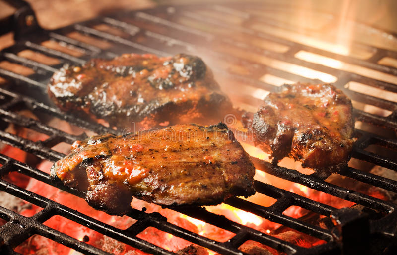 Grilling marinated meat stock photo