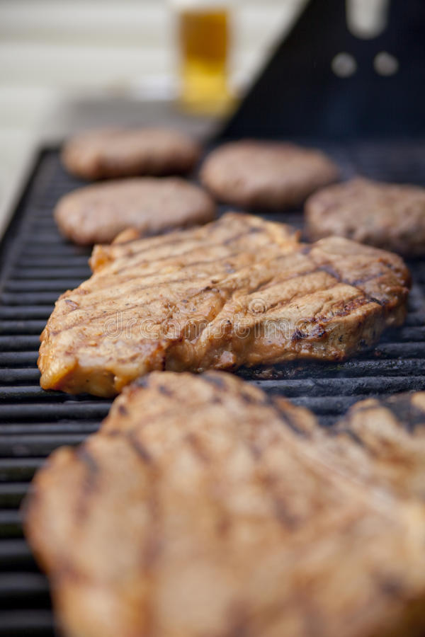 Grilling meat stock photo