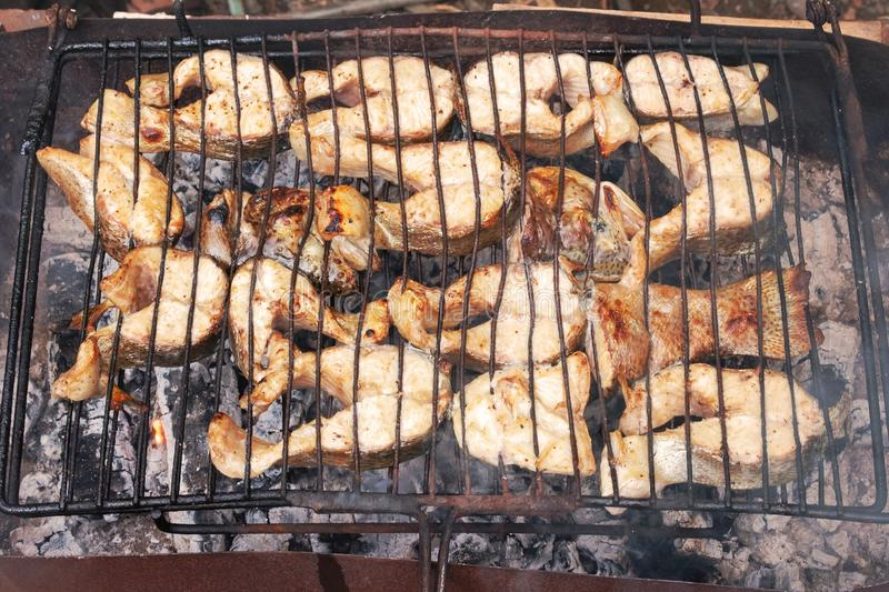 Grilling salmon fish pieces royalty free stock photos