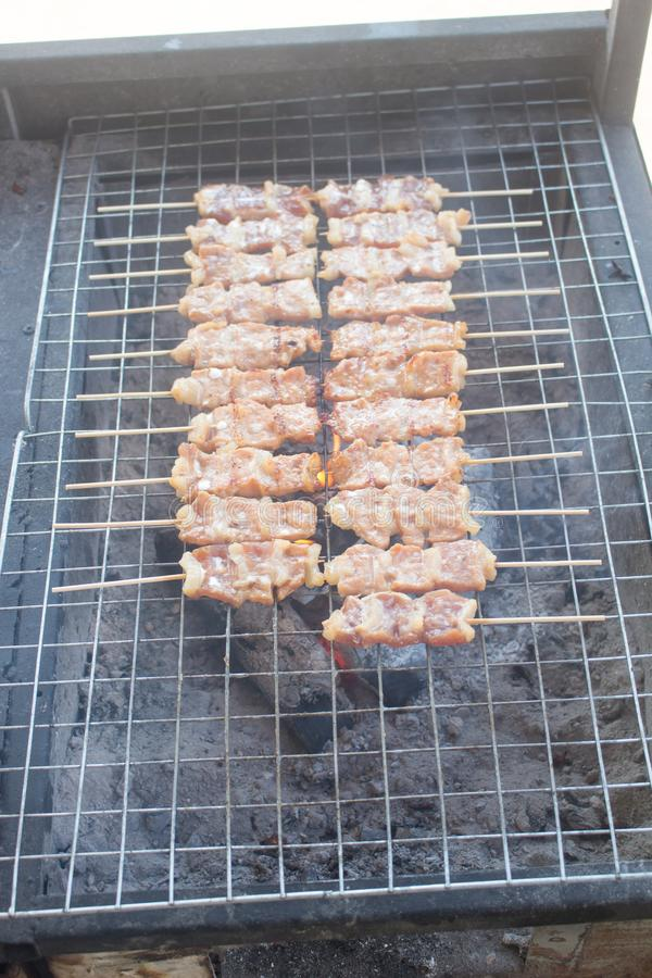 Grilling shashlik on barbecue grill. Selective focus stock photos