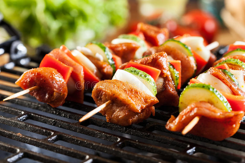 Grilling shashlik on barbecue grill royalty free stock images