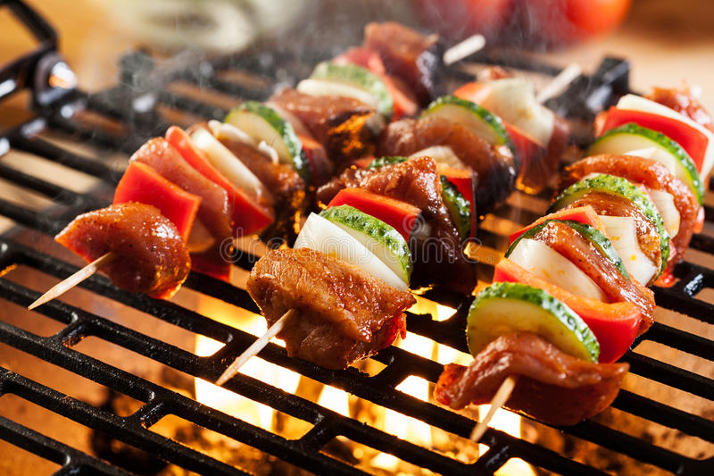 Grilling shashlik on barbecue grill. Selective focus royalty free stock images