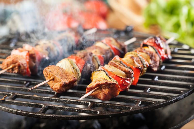 Grilling shashlik on barbecue grill stock photo