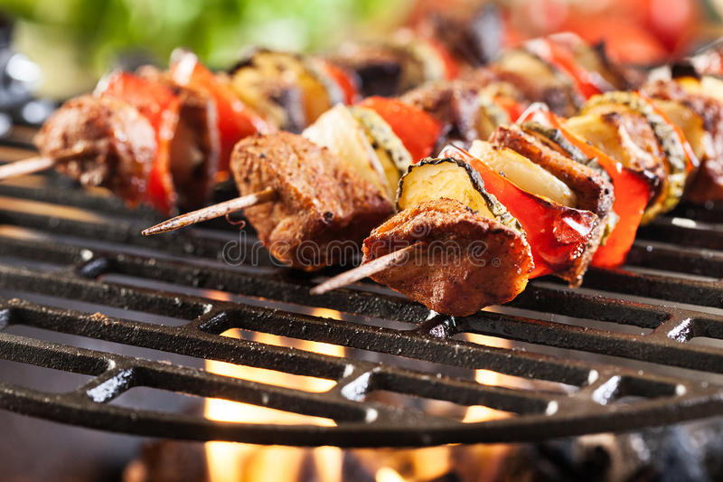 Grilling shashlik on barbecue grill stock photos