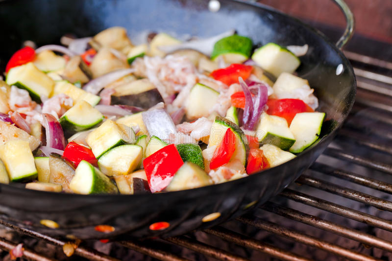 Grilling at summer weekend. Fresh vegetables preparing on grill royalty free stock photography