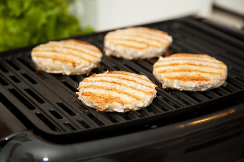 Download Grilling Turkey Burgers Stock Photos - Image: 19566643