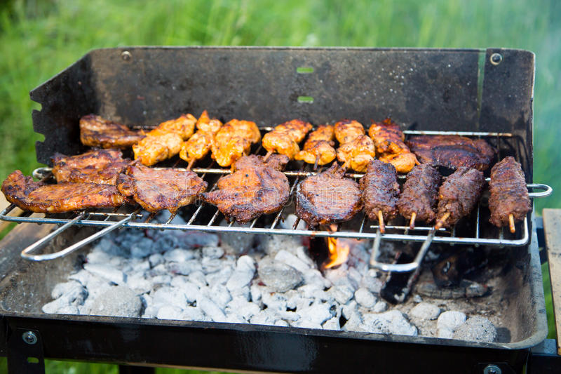 Grilling of various meat varieties in the garden.  royalty free stock photography