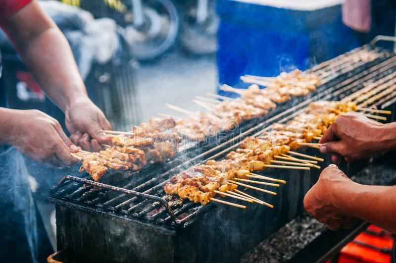 Grillled barbecue pork satay skewers on charcoal grill stove stock images