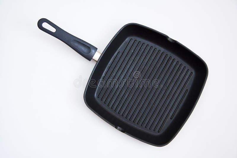Grillpan op wit stock foto