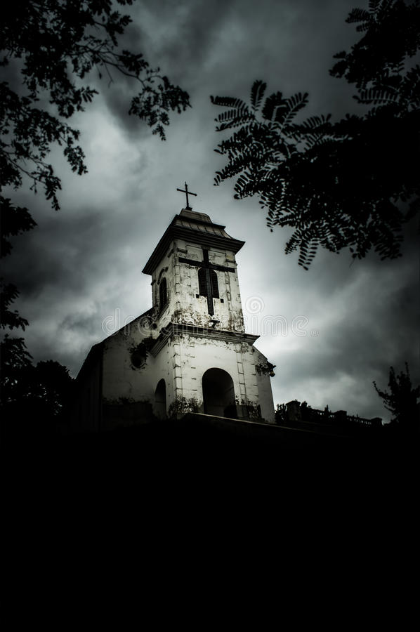 Grim-cloudy day above Church of Holly Cross (Vrsac, Serbia). Spooky scene of the church on the hill, one evening, before the storm stock images