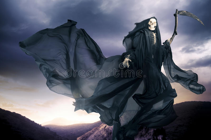 Grim reaper/ angel of death. Grim reaper on a dark background royalty free stock images
