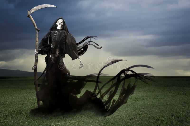 Grim reaper/ angel of death on a meadow royalty free stock photos