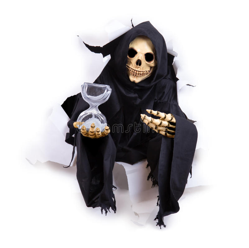 Grim Reaper holding hourglass royalty free stock photos