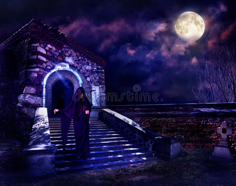 Grim Reaper in hooded cloak. Witch step down in hooded cloak. Halloween horror stock photography