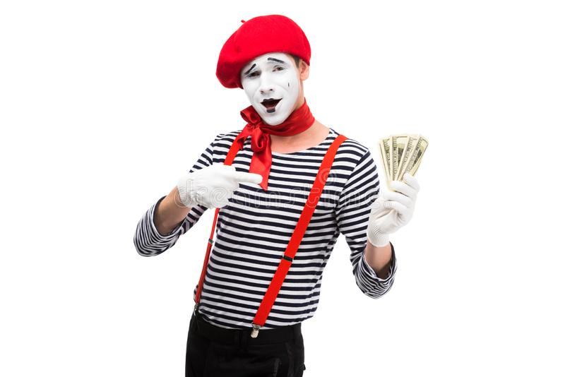 grimacing mime pointing on money stock photos