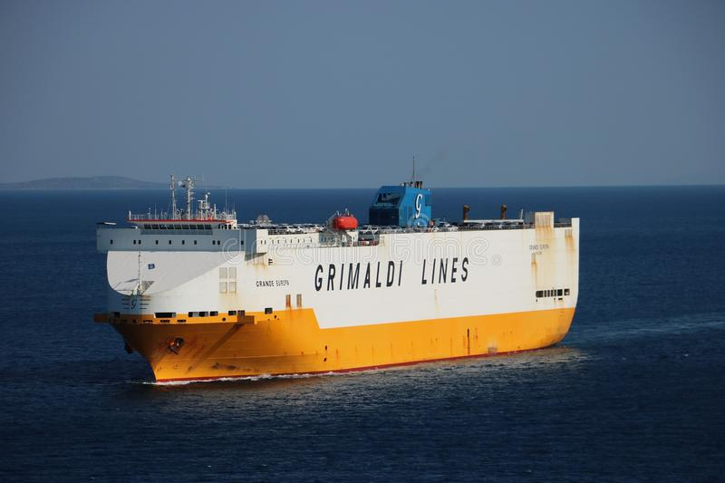 Grimaldi Lines ship. Heading for a Greek port of Piraeus. Grimaldi Lines is a cargo and ferry company, a part of the Italian Grimaldi Group. The Port of Piraeus stock photography