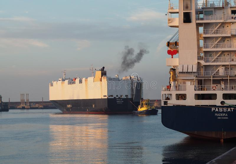 Grimaldi maritime group giant ship. A giant container and general goods from Grimaldi company leaves Leixões harbour in Portugal.Passat containers ship royalty free stock image