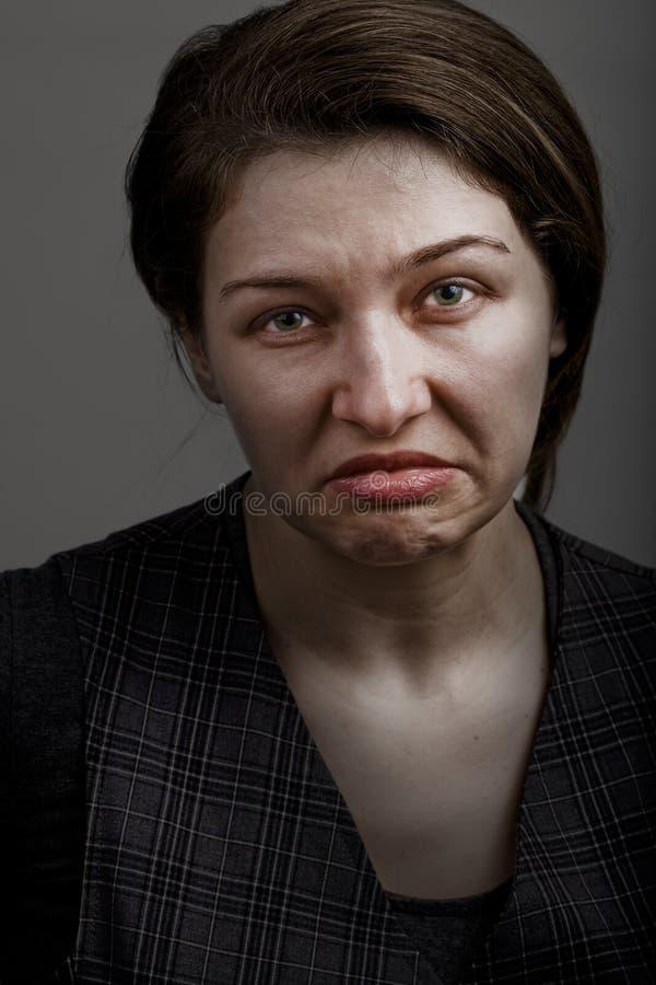 Grimasse der unglücklichen traurigen enttäuschten Frau lizenzfreies stockfoto