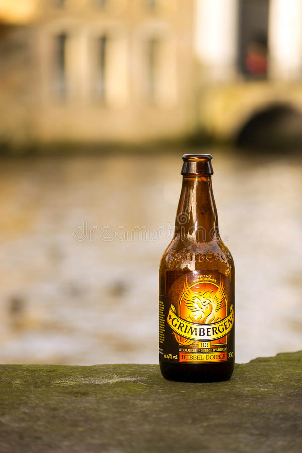 Grimbergen belgian beer bottle. Close-up of an authentic Grimbergen belgian beer bottle near Bruges Canals royalty free stock photo