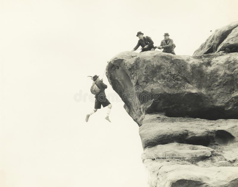 Grimpeur de montagne de délivrance images libres de droits