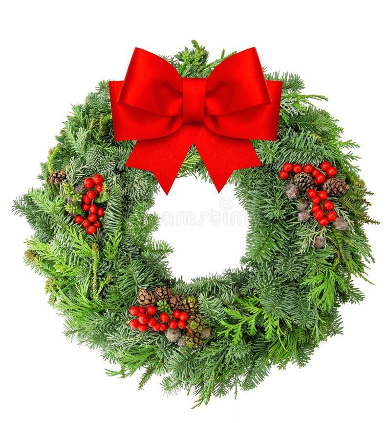 A grinalda do Natal da fita vermelha do pinho e do abeto vermelho curva-se fotos de stock