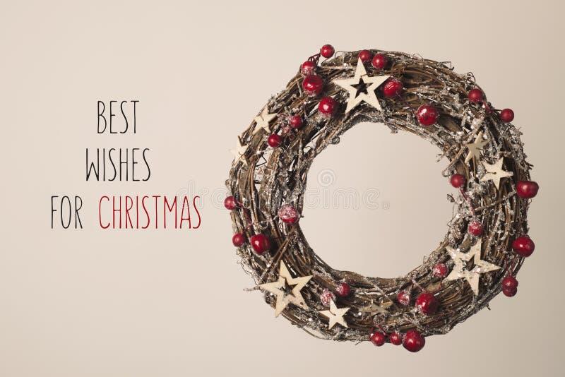 Grinalda e texto cumprimentos para o Natal imagem de stock royalty free