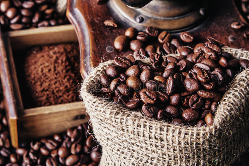 Grinder and coffee beans stock photos