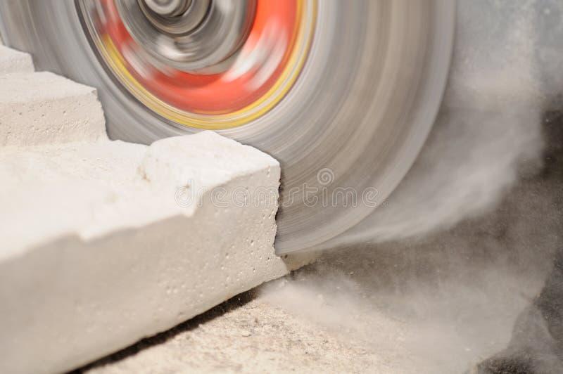 Grinder Cutting Concrete Block stock images