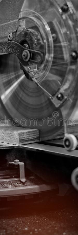 Grinder cutting machine cutting a piece of wood. At workshop stock photography