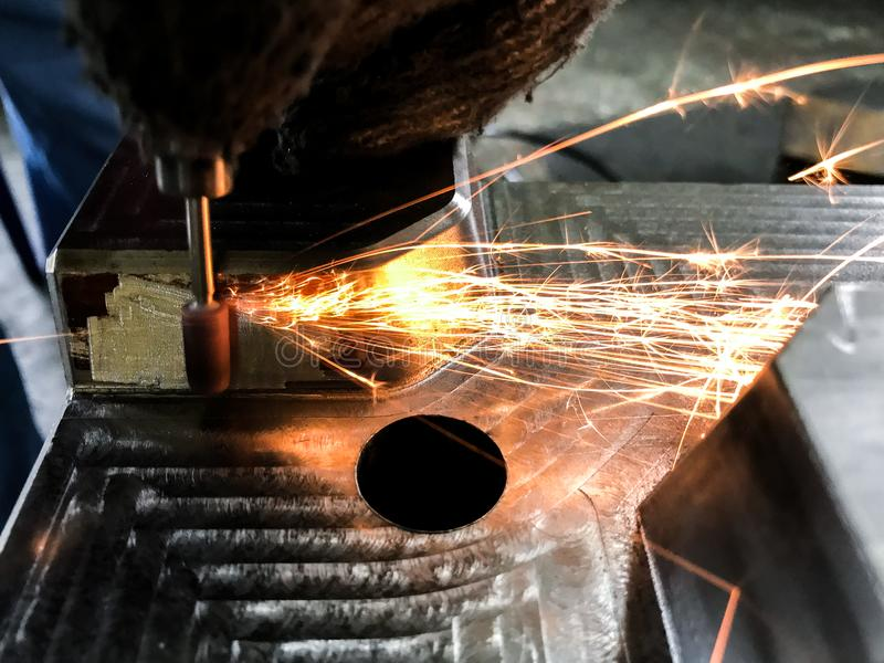 Welding and grinding within the manufacturing process Sparks and smoke. royalty free stock image