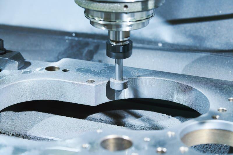 Grinding or polishing metal detail on CNC machine. stock photos