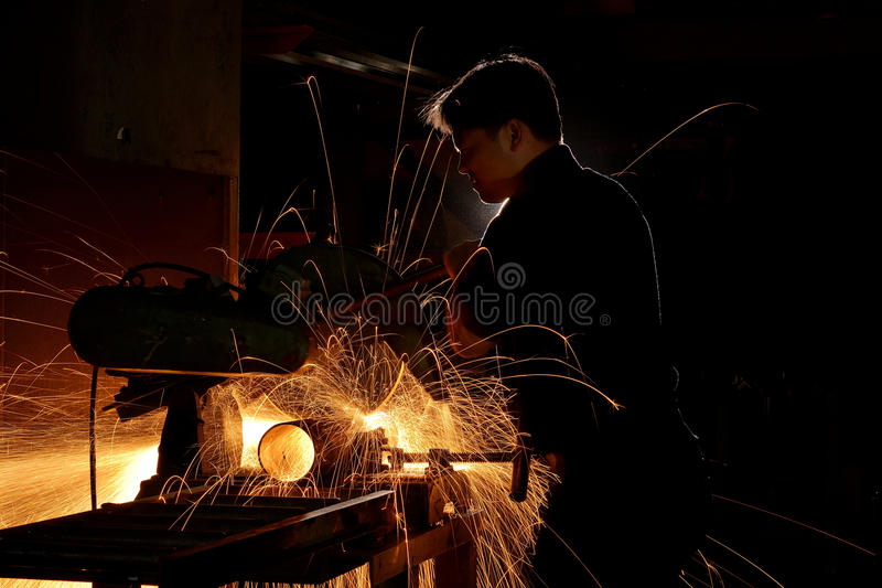 Grinding sparks. Sparks during working with steel in the factory
