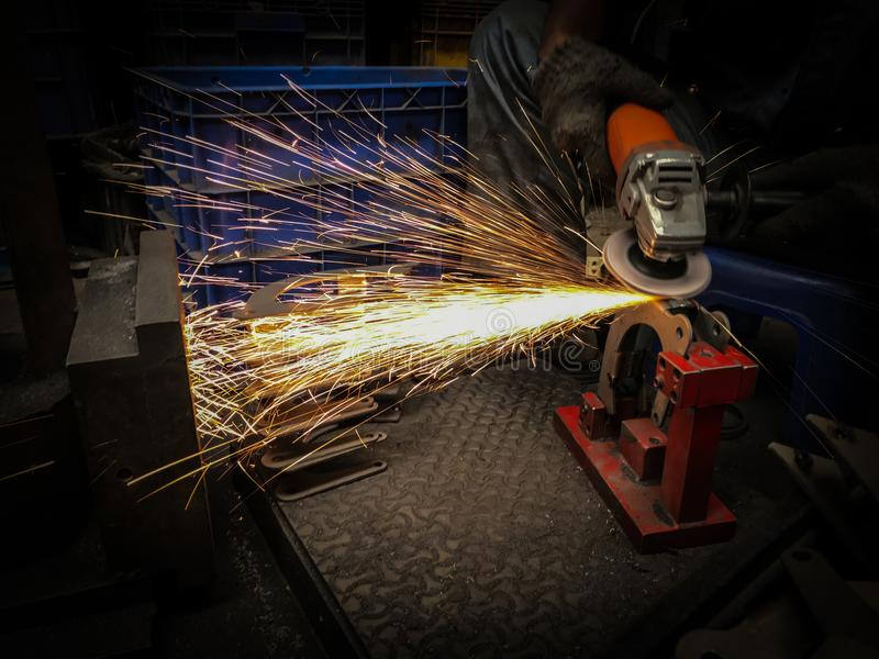 Grinding. Sparks and smoke caused by grinding in production process process grinding concept royalty free stock image