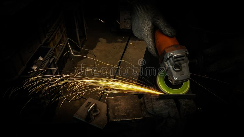Grinding. Sparks and smoke caused by grinding in production process process grinding concept stock images