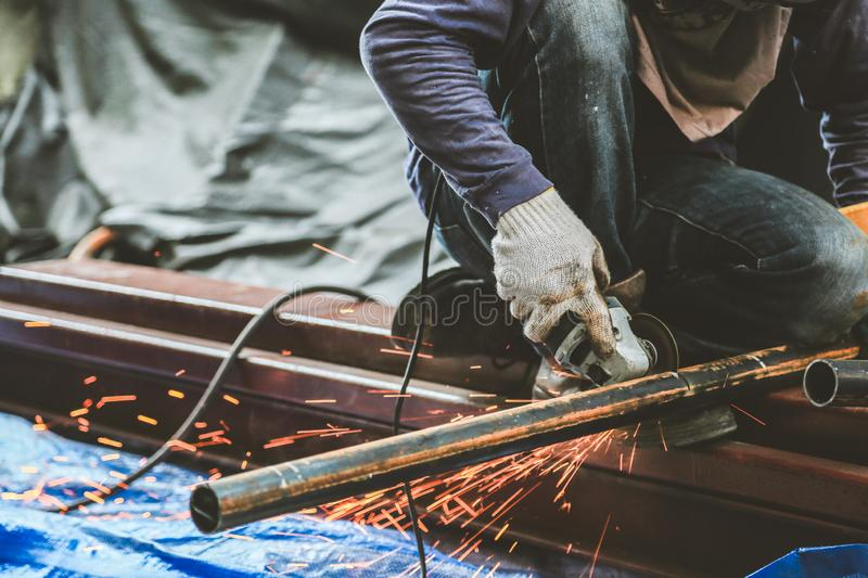 Grinding steel and Steel welding royalty free stock photo