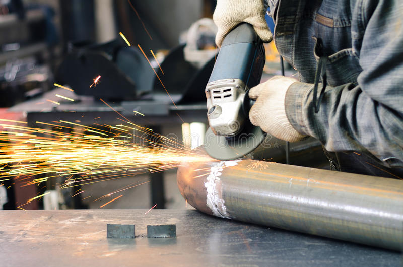 Grinding tool to smooth the weld metal stock photos