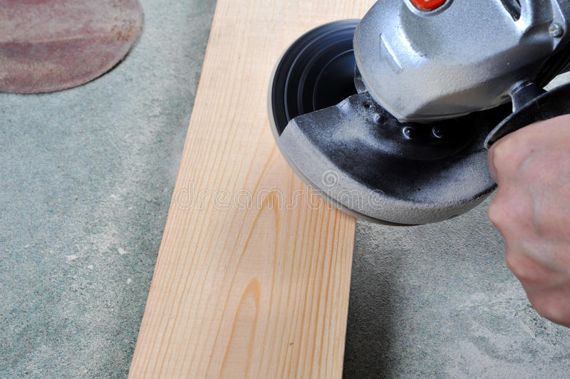Grinding wood stock images