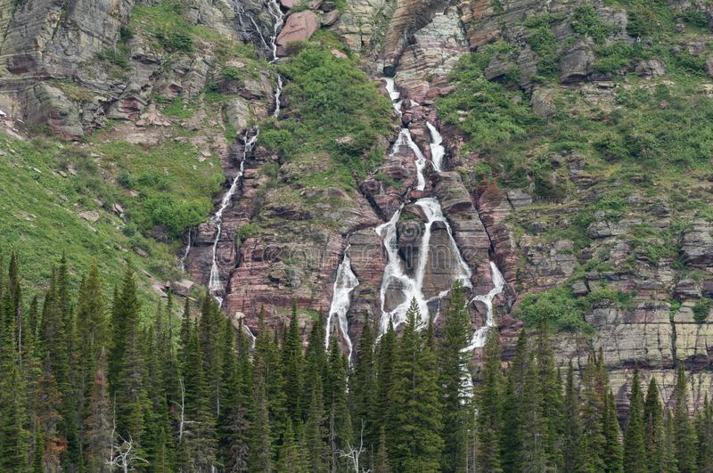 Grinnell Falls Tumble Over Montana Mountains. In Glacier Wilderness stock photography
