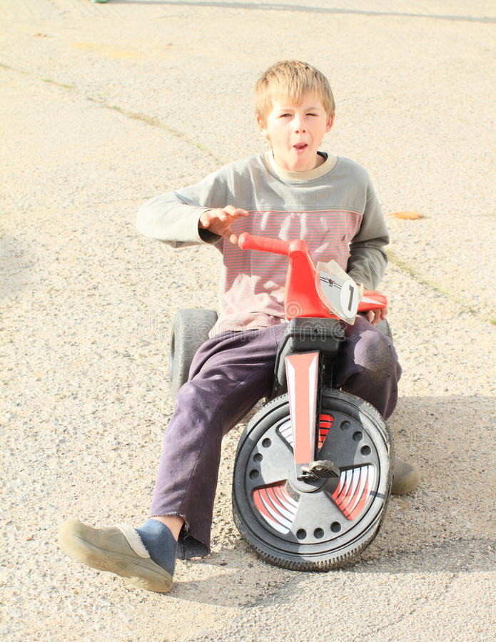 Grinning boy on motorbike royalty free stock photo
