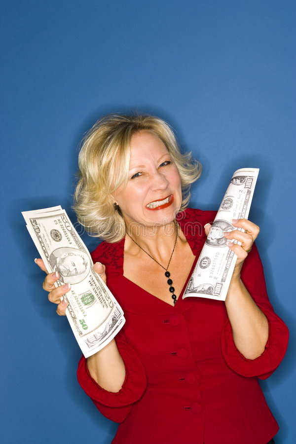 Grinning Wealthy Woman royalty free stock images