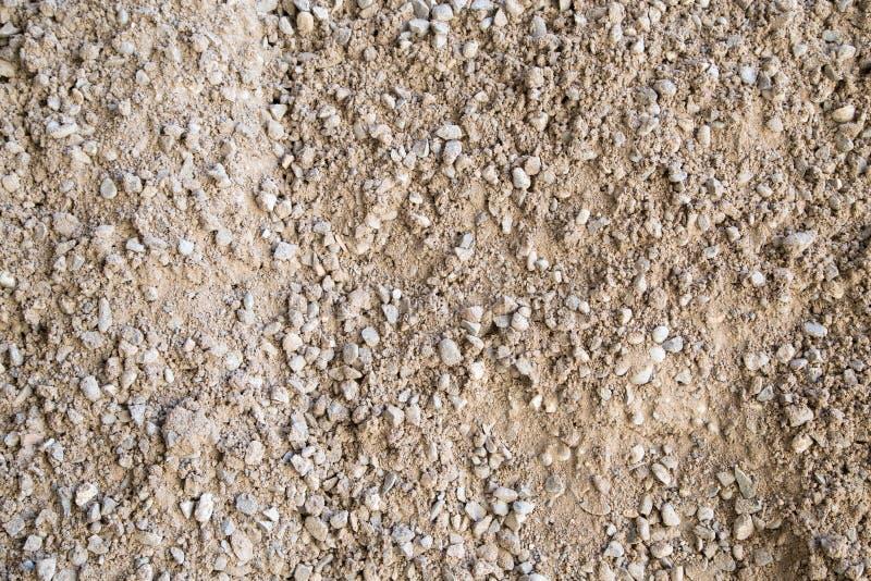 Grint, kiezelstenen en zandclose-up stock afbeeldingen