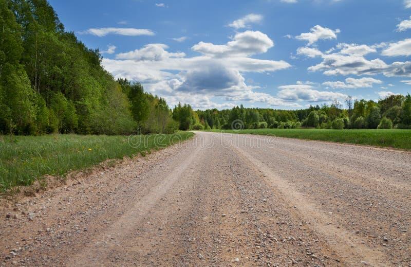 Grintweg in platteland royalty-vrije stock fotografie