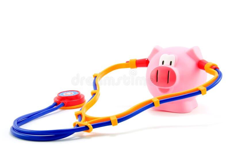 Gripe do porco com stethoscoop foto de stock royalty free