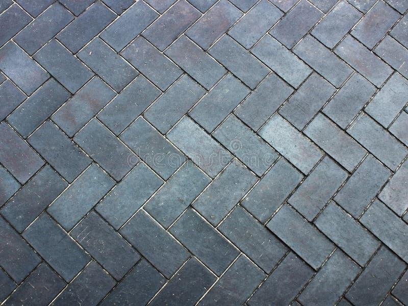 Gris de la textura del pavimento de la teja imagenes de archivo