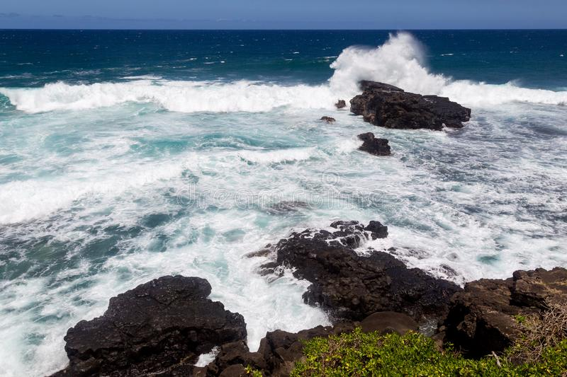 Gris Gris, Mauritius. Waves breaking at the rocks at Gris Gris in Souillac at the south coast of Mauritius, Africa royalty free stock photo