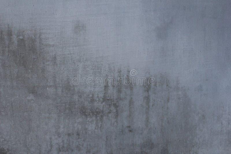 Gris texture des murs en béton avec rayures et fissures photo stock