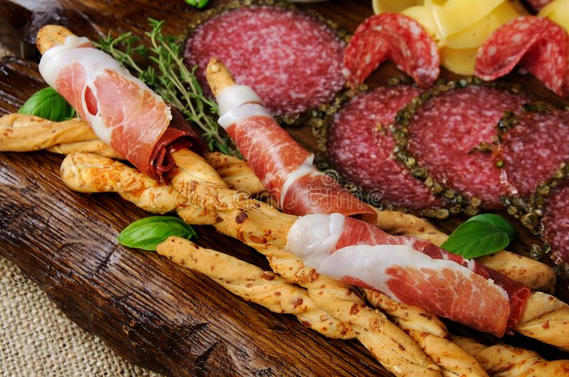 Grissini with prosciutto stock photography