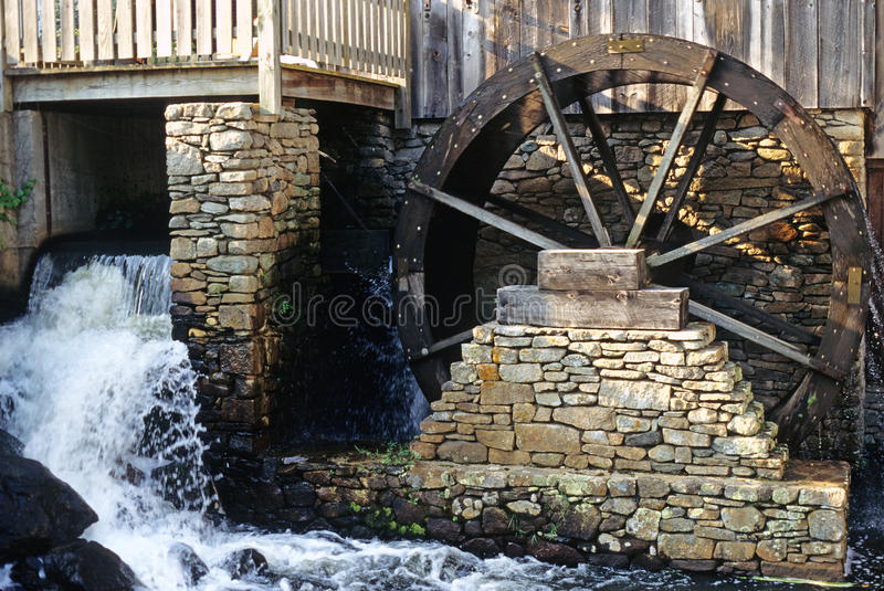 Grist mill and waterwheel royalty free stock photography
