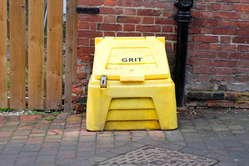 Grit box. The yellow grit boxes there for community use in times of ice and snow royalty free stock photography