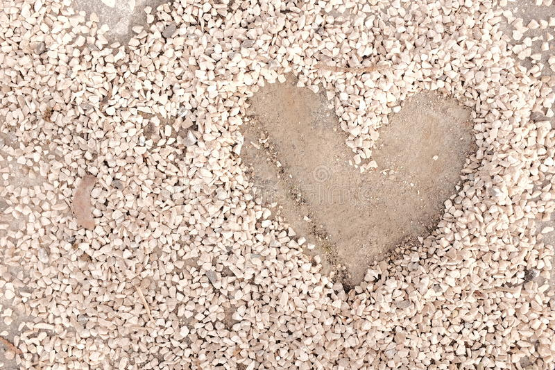 Grit heart. Heartshape made into gritting material for your abrasives and love concepts - copy space to the left stock photos